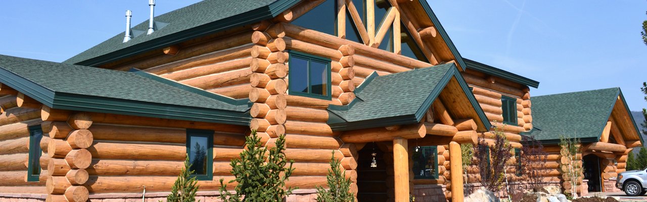 log home builders, log trusses, hand hewn log railings, custom log homes, log fireplace mantels, log furniture, log products, log railing fabricators